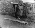 MP-0000.105.4 | Two Inuit women & child at door to earth hut, about 1910 | Photograph | Anonyme - Anonymous |  |