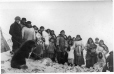 MP-0000.597.19 | John with group of Inuit, Cape Smith, NU, 1922 | Photograph | Captain George E. Mack |  |