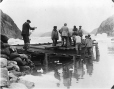 MP-0000.597.143 | Group of men with supply barge at wharf, about 1919 | Photograph | Captain George E. Mack |  |