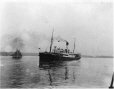 MP-0000.597.153 | Steamship, small sailboat in distance, 1910-27 | Photograph | Captain George E. Mack |  |
