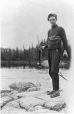 MP-0000.597.184 | Homme tenant un poisson sur un rocher, 1917-1927 | Photographie | Captain George E. Mack |  |