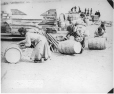 MP-0000.597.192 | Inuit women rolling supply barrels, about 1919 | Photograph | Captain George E. Mack |  |