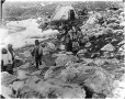 MP-0000.597.213 | Inuit women and children on rocky shore, about 1919 | Photograph | Captain George E. Mack |  |