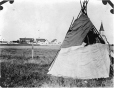 MP-0000.597.267 | Tent in foreground, trading post in distance, Moose Factory, ON, about 1919 | Photograph | Captain George E. Mack |  |