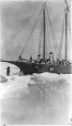 "MP-0000.597.341 | Hudson's Bay Company schooner ""Nannuk"" in ice, with crew, 1921(?) 