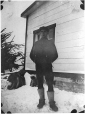 MP-0000.597.364 | Man stands in snow beside house, 1920-27 | Photograph | Captain George E. Mack |  |