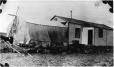MP-0000.597.366 | Clapboard house with canvas tent extension, 1910-27 | Photograph | Captain George E. Mack |  |