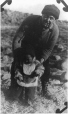 MP-0000.597.417 | Captain Mack with Inuit toddler, 1915-20 | Photograph | Anonyme - Anonymous |  |