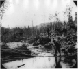 MP-0000.103.34 | Miners crossing creek, Bonanza Trail, YT, about 1898 | Photograph | Edwin Tappan Adney |  |