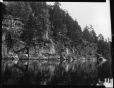 MP-0000.2141.19 | Rock face at water's edge, far end of Little Missinabie Lake, ON, 1930 | Photograph | Edwin Tappan Adney |  |