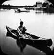 MP-0000.25.38 | Young man in Iroquois costume, paddling a canoe, about 1900 | Photograph | Anonyme - Anonymous |  |