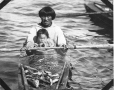 MP-1976.25.135 | Inuit man and children in kayak, Port Harrison, QC, about 1920 | Photograph | Samuel Herbert Coward |  |