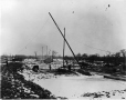MP-1977.76.179 | Derrick on construction site, winter, about 1900 | Photograph | Alfred Walter Roper |  |