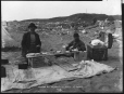 MP-1979.111.123 | Miners eating lunch on beach at Nome, Alaska, 1900 | Photograph | Edwin Tappan Adney |  |