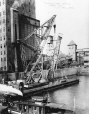 MP-1979.155.170 | Floating crane lifting marine leg, Montreal harbour, QC, 1909 | Photograph | Anonyme - Anonymous |  |