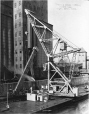 MP-1979.155.171 | Floating crane lifting marine leg, Montreal harbour, QC, 1909 | Photograph | Anonyme - Anonymous |  |