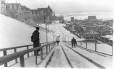 MP-1984.146.2.10 | Two men skiing on toboggan slide, Dufferin Terrace, Quebec City, QC, about 1900 | Photograph | Anonyme - Anonymous |  |