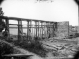 MP-1985.31.115 | Trestle and abutments, Bout de L'Isle, QC, about 1900 | Photograph | N. M. Hinshelwood |  |