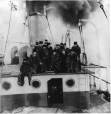 MP-1986.9.5.13 | Group in fur coats on ship's deck, about 1910 | Photograph | W. O. K. Ross |  |