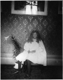 MP-1987.22.2 | Girl with lily, against wallpaper, QC, about 1900 | Photograph | Mr. Bishop |  |