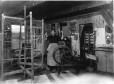 MP-1992.9.2.14 | Woman winding warp from reels, QC, about 1920 | Photograph | Sydney Jack Hayward |  |