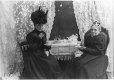 MP-1994.32.6 | Ladies at tea, oranges & cookies, QC, about 1900 | Photograph | Sally Eliza Wood |  |