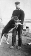 "M2000.113.6.153 | Unidentified man with police dog ""Mike"", Fort Churchill, MB, 1909 