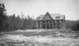 M2003.28.125   Building in woods, near Halcyon Hot Springs, Arrow Lakes, BC, 1907   Photograph   Burkewood Welbourn     