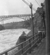 M2003.28.64 | Bridge across the Niagara River, Niagara, ON, 1907 | Photograph | Burkewood Welbourn |  |