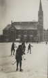 M2011.64.2.2.190.1 | Children playing hockey on large rink with church in background, Trois-Rivières (?), QC, about 1914 | Photograph | Harry Sutcliffe |  |