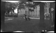 M2011.64.2.3.298N1 | Two children sitting on dog statue on the grounds of Sacred Heart boarding school, Sault-au-Récollet, QC, about 1925 | Photograph | Harry Sutcliffe |  |