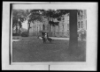 M2011.64.2.3.298N2 | Two children sitting on dog statue on the grounds of Sacred Heart boarding school, Sault-au-Récollet, QC, about 1925 | Photograph | Harry Sutcliffe |  |