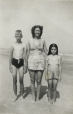 M2011.64.2.6.212 | Janet Sutcliffe on the beach with her children Frank Junior and Shirley, 1940 | Photograph |  |  |