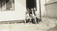 M2011.64.2.6.213 | Frank Sutcliffe Junior, Shirley Sutcliffe and Frank Sutcliffe Senior sitting on porch, 1940 | Photograph |  |  |