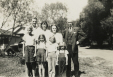 M2011.64.2.6.221 | James Steel posed with his daughters and grandchildren, 1940 | Photograph |  |  |