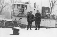 "MP-0000.2361.13 | Lockmen with tug ""Stormont"" at No. 5 lock, Lachine Canal, Lachine, QC, 1968 