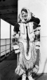 MP-0000.597.311 | White woman wearing Inuit costume on board ship, 1910-27 | Photograph | Captain George E. Mack |  |