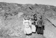 MP-0000.598.13 | Three young women, Inuit costume, one carrying a child, about 1925 | Photograph | Captain George E. Mack |  |