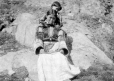MP-0000.598.23 | Inuit woman and child, on rock, about 1925 | Photograph | Captain George E. Mack |  |