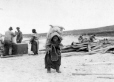 MP-0000.598.46 | Woman transporting large sack on her back, about 1925 | Photograph | Captain George E. Mack |  |