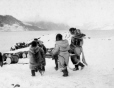 MP-0000.598.54 | Group carrying a wooden pallet, Pangnirtung, NU, about 1925 | Photograph | Captain George E. Mack |  |
