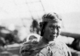 MP-0000.598.63 | Woman wearing headband, about 1925 | Photograph | Captain George E. Mack |  |