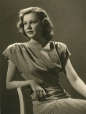 MP-1975.2.28 | Young woman seated, ca 1945 | Photograph | Adolphe |  |