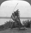 "MP-1981.94.92.1 | ""Indian"" scout watching Champlain's approach, Quebec Tercentenary, Quebec City, QC, 1908 