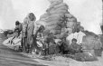 MP-1984.126.154 | Inuit women and children with post supplies, 1920 | Photograph | Anonyme - Anonymous |  |