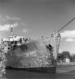 MP-1998.2.5563 | Warship 402, a corvette, probably in the Port of Montreal, QC, 1946-1952 | Photograph | Russell Bartlett |  |