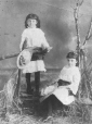 N-1982.11.2 | Two young girls in matching white dresses, St. John, NB, about 1878 | Photograph | James Notman |  |