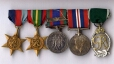1967.26N | Left to right: 1939-1945 Star, The Pacific Star, Canadian Volunteer Service Medal, , 1939-1945 War Medal, Royal Canadian Naval Reserve Officer's Decoration | Medal |  |  |