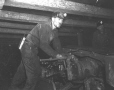 19752400062   Miners operating an unidentified machine in Galt Mine No. 8   Photograph   The Lethbridge Herald     