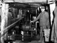 19752400070 | Miner operating a winch in the Chester Mine | Photograph | The Lethbridge Herald |  |